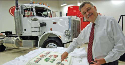 Peterbilt General Manager Bill Jackson cuts the company's 70th anniversary cake at the Denton, Texas, plant. The white Model 359 was the first truck off the plant's assembly line when it opened 29 years ago.