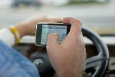 Survey: Firms know of cell phone use