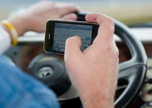 Ruling bans handheld phones for truckers Jan. 3