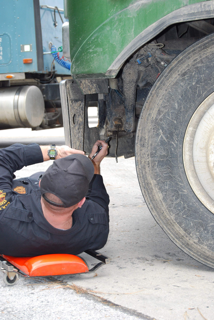 Inspector under truck