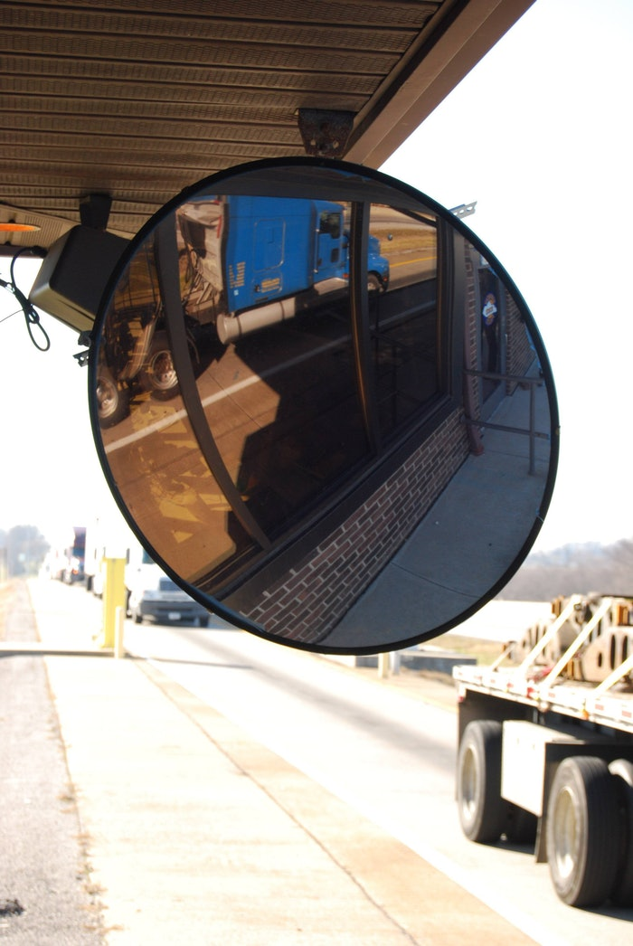 Mirror and trucks at inspection station
