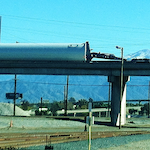 """A receiver snapped this pic waiting on the driver to get to his location """"so we can unload him."""" Authorities, however, due to the width and weight of the loaded pipe, had to """"shut down the bridge so he could get to us."""""""