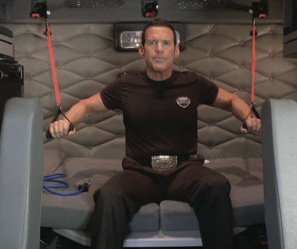 """""""Trucker Trainer"""" Bob Perry, president of Rolling Strong (Freightliner's partner in building the FIT system), works out with the FIT system in the sleeper of a Cascadia."""