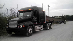 """B&D Transport owner-operator Brad Lambert uses the PrePass weigh-station bypassing system in his 2003 Freightliner Century at a cost of $13.50 a month, discounted via his Owner-Operator Independent Drivers Association membership. """"I don't get pulled into the scale houses most of the time,"""" he says."""