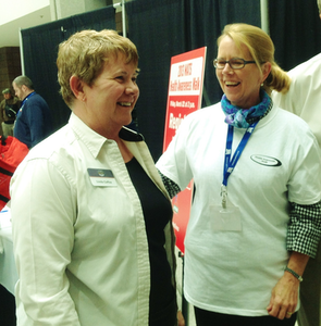 Owner-operator Linda Caffee shares a laugh with the Administrator