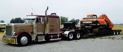 Rob Hale Trucking of  Wynne, Ark., delivered this giant Hyundai trackhoe for the Arkansas Highway Department.