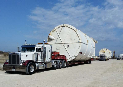"105-foot long by 20-foot wide by 22-foot, 3 inches high, Darrell Hendrix of STS Heavy Hauling said of these silos. ""The customer was told they could not be moved in one piece... But we moved 12 of them in one piece."""