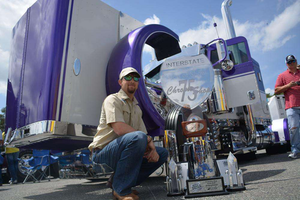 Austin Ashley poses with his Best of Show trophy — among other pieces of hardware — and his 2007 Peterbilt 379.