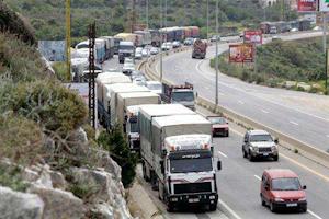 Syrian trucks backed up on bridge in Jordan