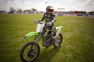 Kelly here is engaged in a favorite pastime that extends from childhood motocross racing.