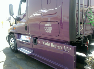 Letter writer Bob Sauter's third truck leased with Prime Inc. is this purple 2013 Freightliner Cascadia, lettered with the message of the pastor's Sunday call-in CDL Drivers Church of Delivery. Read more about it here.