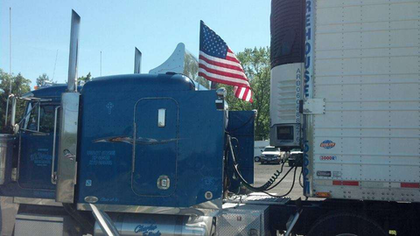 Charles Linde's truck flies the flag
