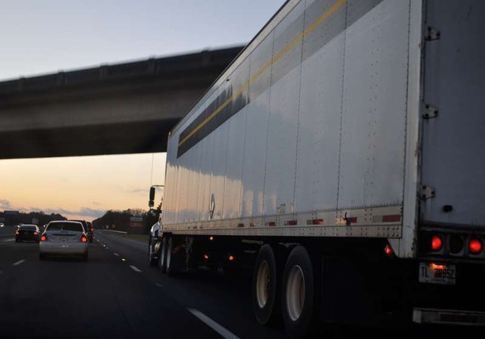 Rolling truck on highway at dusk