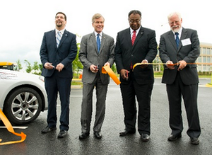 Virginia Gov. Robert McDonnell, second from left, helps cut a ribbon for the Virginia Connected Test Bed.
