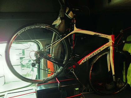 Almendarez says his employer's been accommodating when it comes to many aspects of encouraging fitness on the highway -- he was able to remove the passenger seat in his company tractor to fit his sweet Wilier road bike, back tire here shown resting on the bungee'd microwave, sitting more or less where the seat had been. The front tire, he says, comes close to the back of the bunk but leaves plenty of room for sleeping.