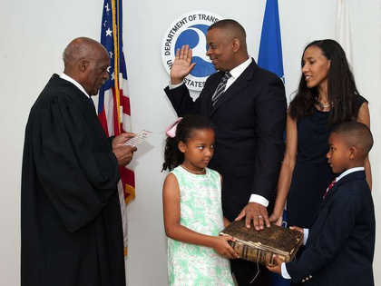 Secretary of Transportation Anthony Foxx as he's sworn in, standing next to wife Samara and children Hillary and Zachary.