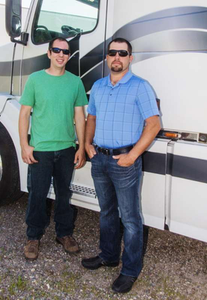 """""""His strengths are my weaknesses, and my strengths are his weaknesses,"""" says Chris Litzinger (left), half of a Brenny Transportation-leased owner-operator team with Henry Kuperus. """"Henry's a paperwork guru"""" and is the team's business-record keeper and go-to guy come tax time. The co-owners cite an enduring friendship as key to their partnership on their 2005 Volvo."""