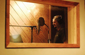 Tony Justice in the vocal booth at County Q Studios.