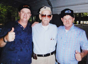 Billy Cockerill (center) with Ardis (left) and J.B. Hodge -- Cockerill is the most senior member of the S.C. operators, with 60 years of driving in his side-view.