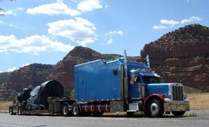 """HOME ON THE ROAD"" -- That's how Gregg Blair describes the 1999 Peterbilt he last owned. The big blue truck is a '99 Pete. 600 h.p. C16 cat with auto shift 18 speed. 355 rears. Full length double frame. 500 gallons fuel. The sleeper is a 200"" ICT on air ride bunk mate.  The back 50"" is a garage with an electric motorcycle lift.   Keeps the bike clean like it is in the back seat of your car. I put about 1.75 million miles on that truck. Inside the sleeper,  kitchen, shower & toilet, washer/dryer,  42"" flatscreen with surround sound and tracking satelite TV dish.  Heated floor. 15K btu A/C. 8K diesel generator.  Home on the road."