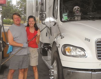 Gary and Barb Shade with pup Oliver and the couple's Freightliner M2 expediter