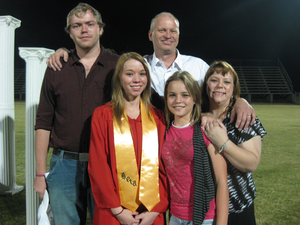 Tim Young (white shirt) and his family.