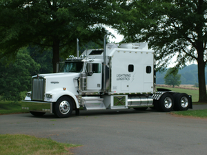 """The sister truck to this beautiful Lightning Logistics-owned 2001 Kenworth W900 with a 2001 500-hp Caterpillar C15 engine – """"sort of our flagship truck,"""" says co-owner Joe Hammerslough – is spec'd similarly and owned by an owner-operator leased to the company who has family ties in the Bay Area and is paying off a new transmission. """"He's not looking forward to getting rid of his truck"""" just to run in California."""
