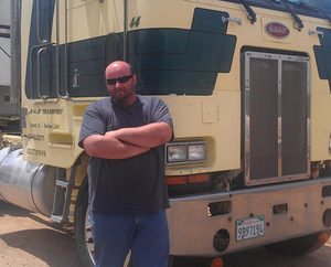 Martin Jez, with a 1980s Peterbilt he owned for a time before moving on with the 2000 Freightliner he owns today. The Freightliner falls this year under the prohibition on 1996-2006 model-year diesel engines operating in the state that is the CARB Statewide Truck and Bus Rule.