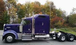 Small fleet owner-operator Chip Shirey's XXX Kenworth W900, hauling a variety of open-deck freight.