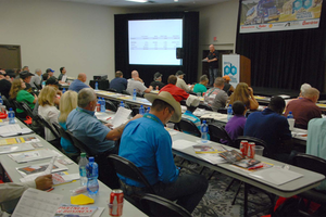 Trucking radio host Kevin Rutherford addresses owner-operators at Overdrive's Partners in Business seminar.