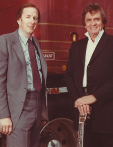 Former Fruehauf executive Michael Davis and Johnny Cash in a promotional photo.