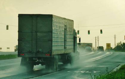 Truck in rain on highway