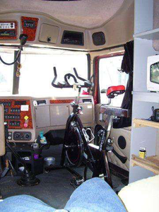 Wilson recommends small changes for getting in shape on the road -- things like not taking the closest parking spot, or walking a few laps around the truck. If you have his dedication to progressing in fitness, then consider bigger changes, like his installation of a stationary bike in the cab.