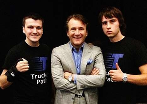 Trucker Path reps with Shark Tank biz start-up competition show actor Robert Herjavec.