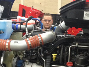 Brain Smith, from Rush Truck Center - Austin, troubleshoots a Paccar MX engine.