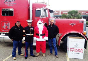 Rodriguez (left) with Sgt. Santa and crew.