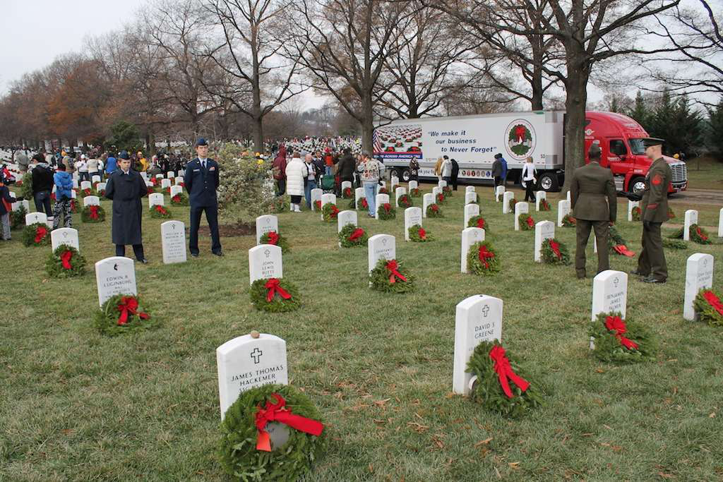 A section of Arlington National Cemetery is adorned with remembrance wreaths that were delivered by Hartt Transportation Systems, Inc.