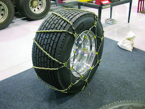 Use only good quality tire chains that fit properly. Put the chains on the tire, drive for about a mile, then check and retighten the chains to ensure a good fit.