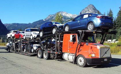"This car hauler is shown on ""Snoqualmie Pass,"" out in Washington State, say Andrew Luedtke, where the operator was ""getting used too the new cars."""