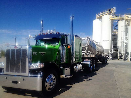 This 2014 Peterbilt 389 was custom-ordered from the Peterbilt plant in Denton, Texas, built for Cris and Kelly Bocanegra of Martindale, Texas. It was put into service just this past October, and is here pictured unloading in Von Ormy, Texas
