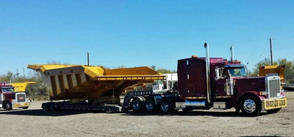 Chris Thompson sent in this shot of a buddy of his' truck pulling the monster Cat bed between Laredo and Houston.
