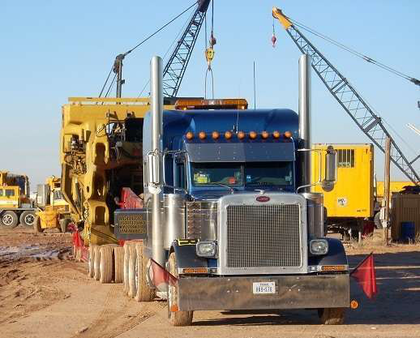 """""""Going the extra mile,"""" says Joe Tex Heavy Haul, with this customer's oversize construction equipment."""