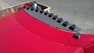 VorBlade's small vortex generator blades are wishbone-shaped airfoils that smooth airflow over a truck's trailing edges like the back of a cab or trailer.