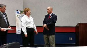 Linda Caffee, driver for FedEx Freight and well known in other circles as a member of the Trucking Solutions Group and blogger for Freightliner's Team Run Smart, accepts her award for being named a 2014 Outstanding Trucker Buddy from Randy Schwartzenburg, president of Trucker Buddy.