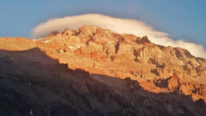 """Aconcagua, at 22,838 feet, is the second-highest of the Seven Summits, the tallest mountains on each continent. Matt Hopkins took this shot of the peak and North Face with his camera phone. """"I turned around at what's known as the White Rocks,"""" he says of the highest elevation he reached, well before the summit. """"There's a spot where you put crampons on and hike across the glacier. I turned around right at the spot where the wind was going to get super bad."""""""