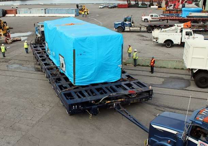 """The 562,000-lb. generator unit pictured here, a separate piece of the haul, moved on a """"24-line dual-lane Scheuerle trailer at the offload at the Port of Long Beach."""" From there, an 800-ton gantry was used to """"load it to railcar, then back to a Scheuerle trailer in Cochise, Ariz., for the border crossing and final leg of the haul to Agua Prieta."""