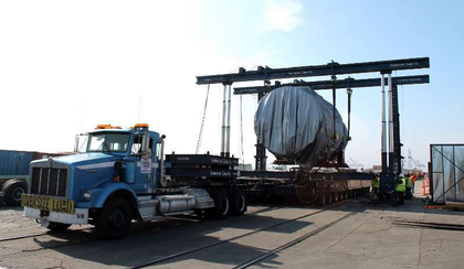 """Pictured here is a 492,000-lb. gas turbine on a Scheuerle like the one used to roll the generator, one of three such turbines that were part of the move. Contractors Cargo's trucks are Kenworth T800W models powered either by 550-hp or 500-hp Cummins engines with, respectively, 18-speed/2-speed auxiliary or 17/4 transmissions. Combinations for larger pulls, depending on grade, typically go as follows: 1 push and 1 pull, or 2 pulling. On the STG module, however, """"we used 4 trucks,"""" said Rabaino, """"either 3 push and 1 pull or 2 and 2."""" Also, all in all, """"more than 70 flatbed loads of components and accessory cargo [is being moved] along with these 5 main large pieces."""""""