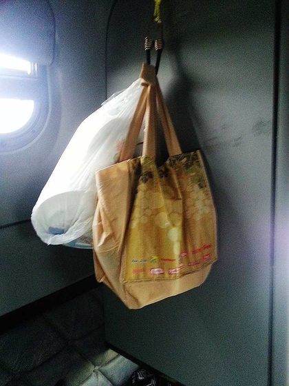 Bottled water stored in a wine bottle bag hangs nicely and doesn't rattle around or take up tons of cabinet space.