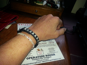 Keeping the number close, in case I need a ride home. (It's still a neat bracelet.)