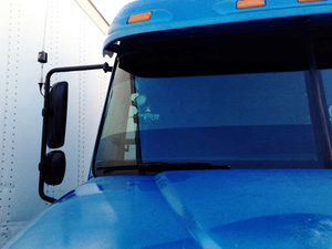"""Independent Brad Willis uses a Blue Tiger video camera on the windshield of his Freightliner Columbia. """"You can set it for the amount of force needed to make it record,"""" he explains. Otherwise, """"it will record in a loop on a mini-SD card,"""" saving over itself unless triggered manually or by a force incident, such as a hard bump or braking maneuver."""